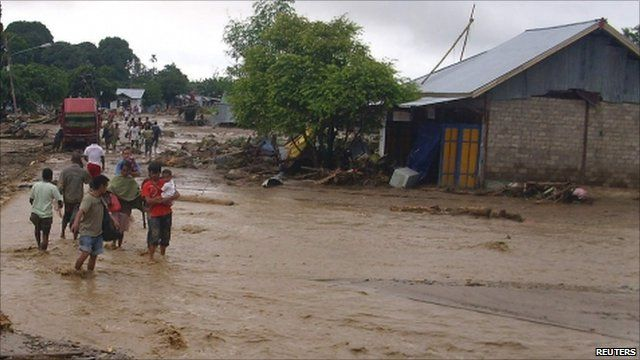 Dozens killed in Indonesia following flooding sparked by torrential rain