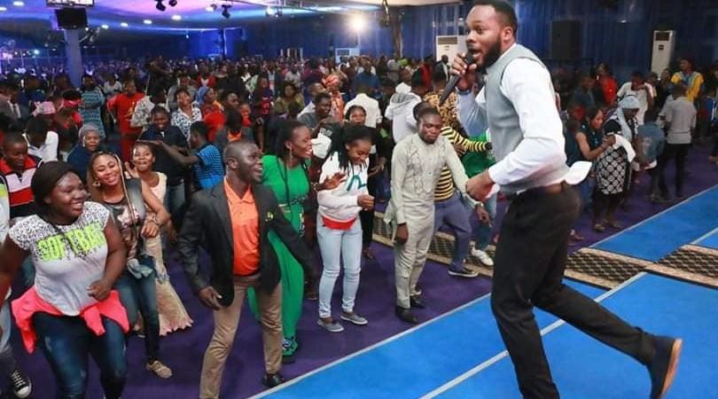 Image of Micheal Arowosaiye dancing