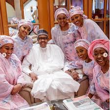 Image of President Buhari and his daughters