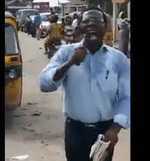 Cosmos Maduka, preaching on the street of Lagos