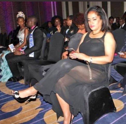 Image of Hon. Esther M. Passaris clad in a revealing black dress attending a beauty pageant.