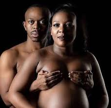 Nude couple in a pregnancy shoot