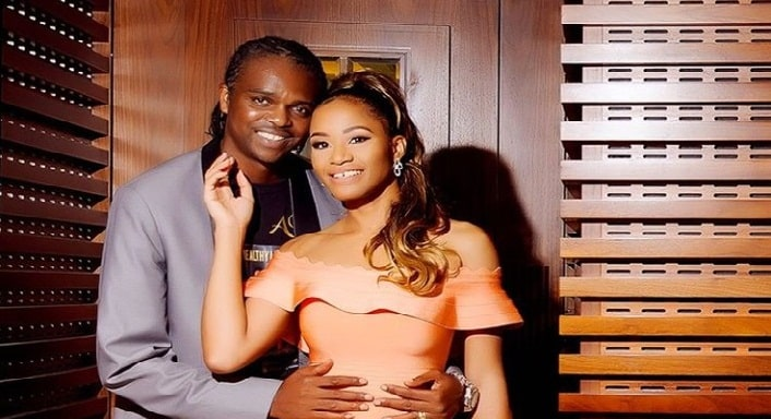 Kanu Nwankwo celebrates his 43rd birthday with his wife, Amara in a close up photo.