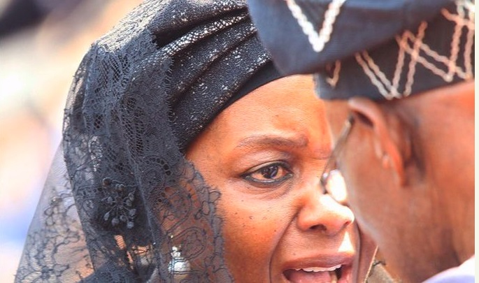 Grace Mugabe cries to Obasanjo during funeral service.